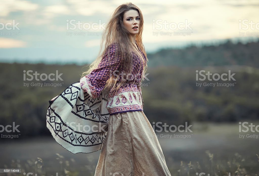 Beautiful hippie girl jumping stock photo
