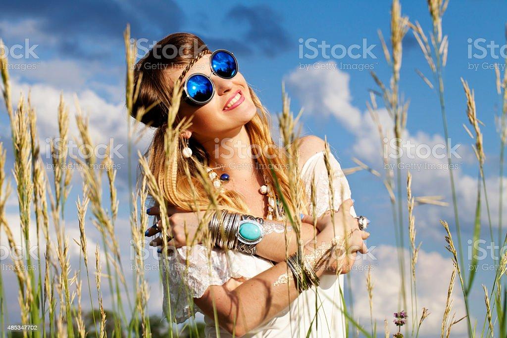 Beautiful hippie girl outdoors stock photo