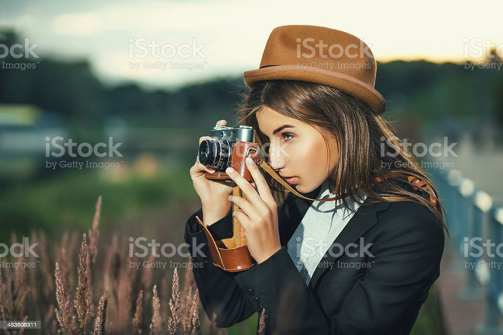 Beautiful hipster girl shooting stock photo