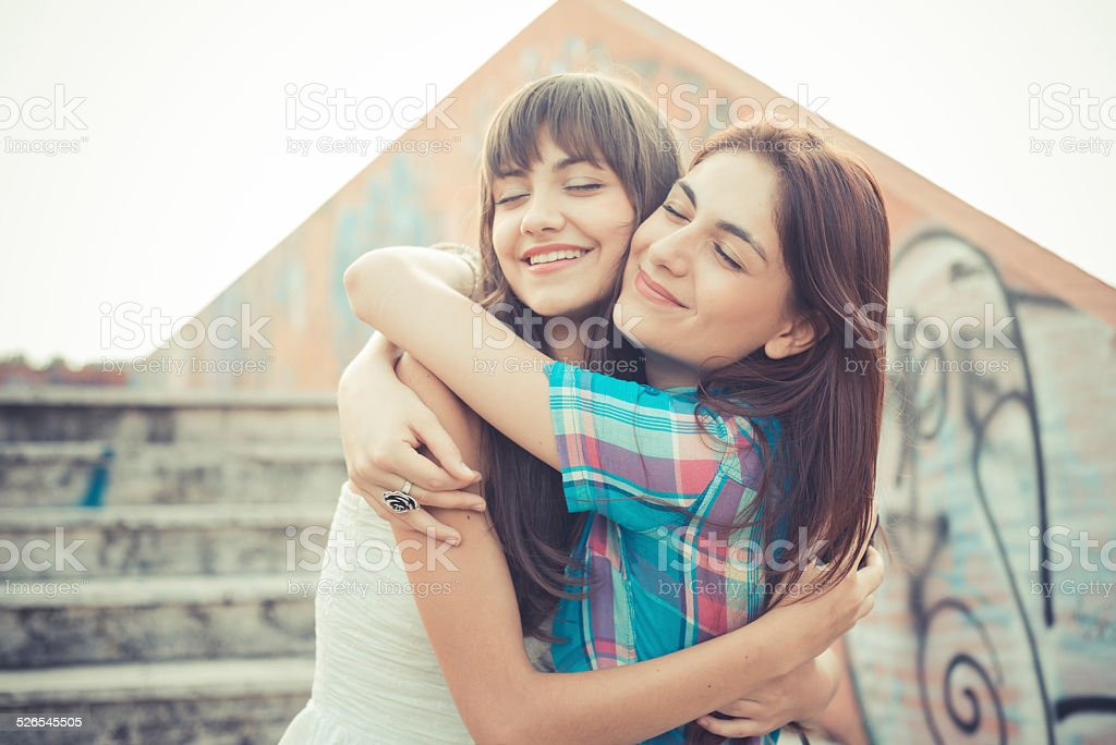 beautiful hipster young women sisters friends stock photo