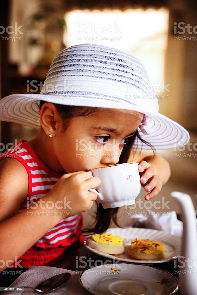 Beautiful Hispanic African American Girl Having a Tea Party stock photo