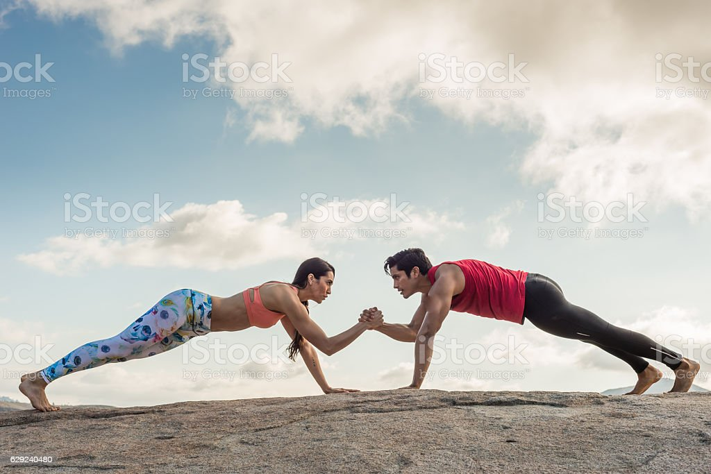 Beautiful Hispanic Couple Exercising Out Outdoors stock photo