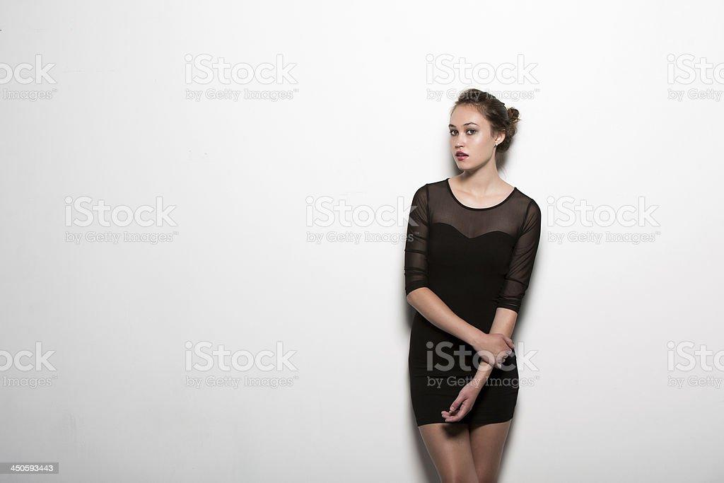 Beautiful hispanic girl in black dress stock photo