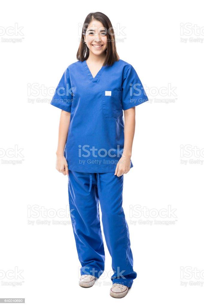 Beautiful Hispanic nurse in a studio stock photo