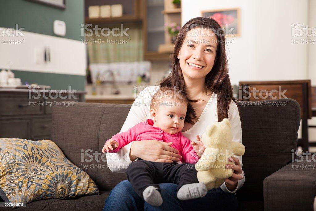 Beautiful Hispanic single mom and her daughter stock photo