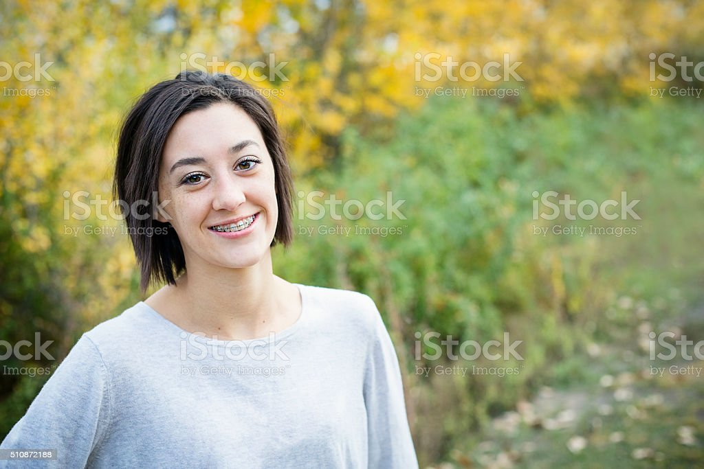 Beautiful Hispanic Teen Girl portrait with braces stock photo