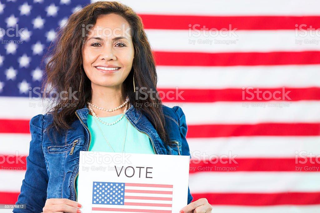 Beautiful Hispanic Woman voted stock photo