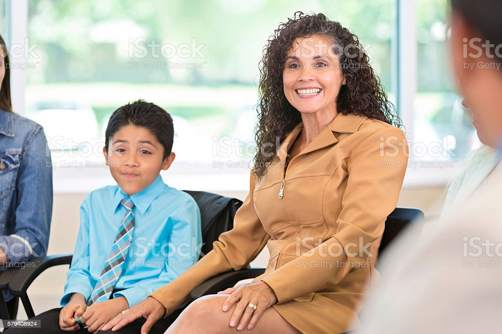 Beautiful Hispanic woman with son stock photo
