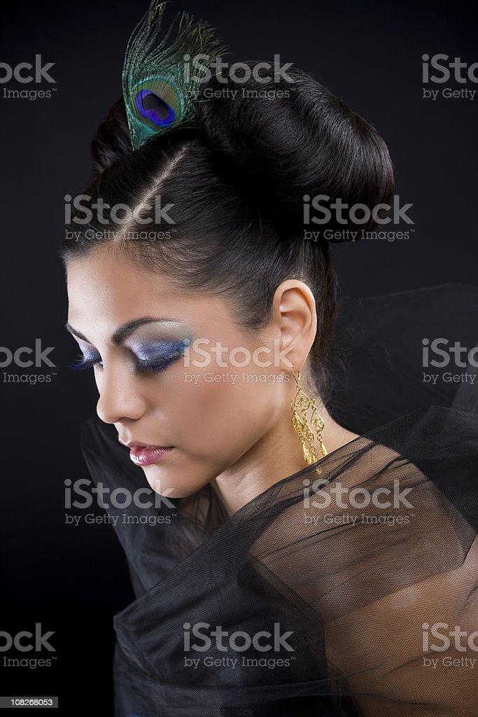 Beautiful Hispanic Woman with Updo Hairstyle royalty-free stock photo