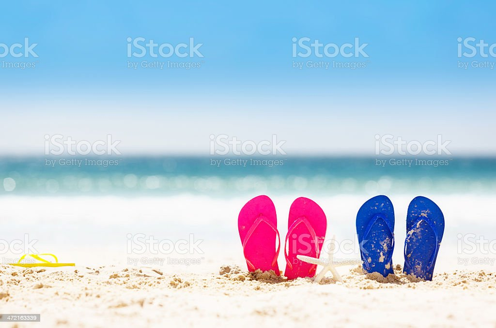 Beautiful holiday background: sand, sea, sandals and starfish! stock photo