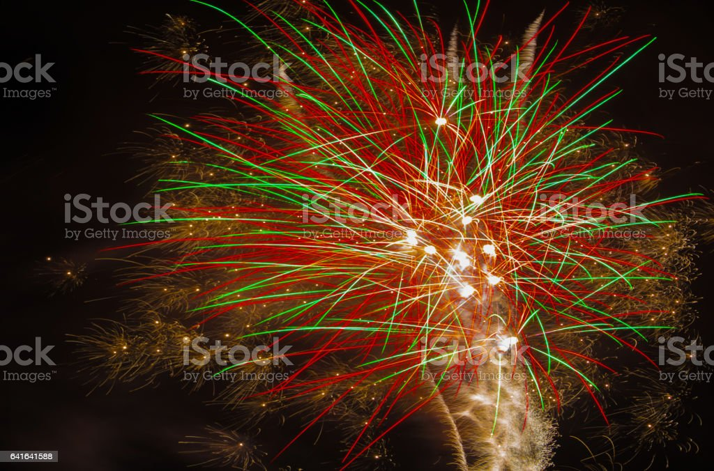 Beautiful holiday fireworks in the night sky stock photo
