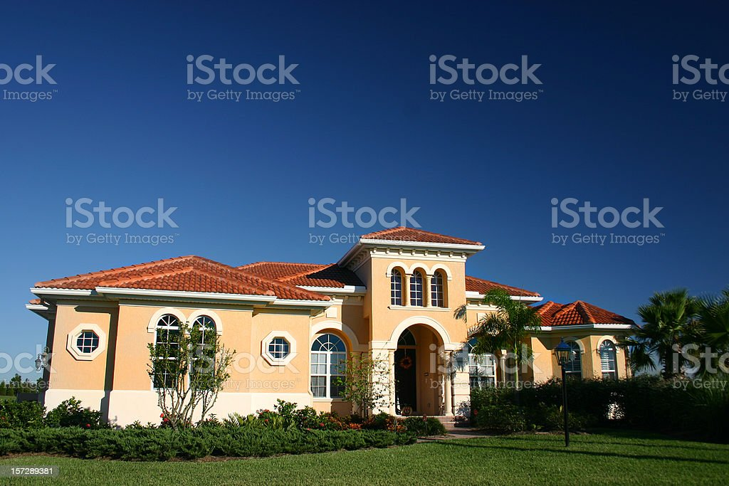 A beautiful home against a blue sky royalty-free stock photo