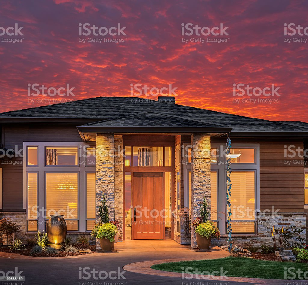 Beautiful Home Exterior with Colorful Brilliant Sky stock photo