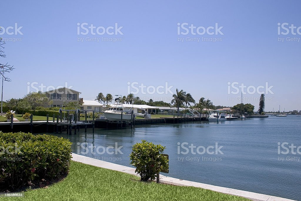 Beautiful homes with docks and boats on a lake stock photo