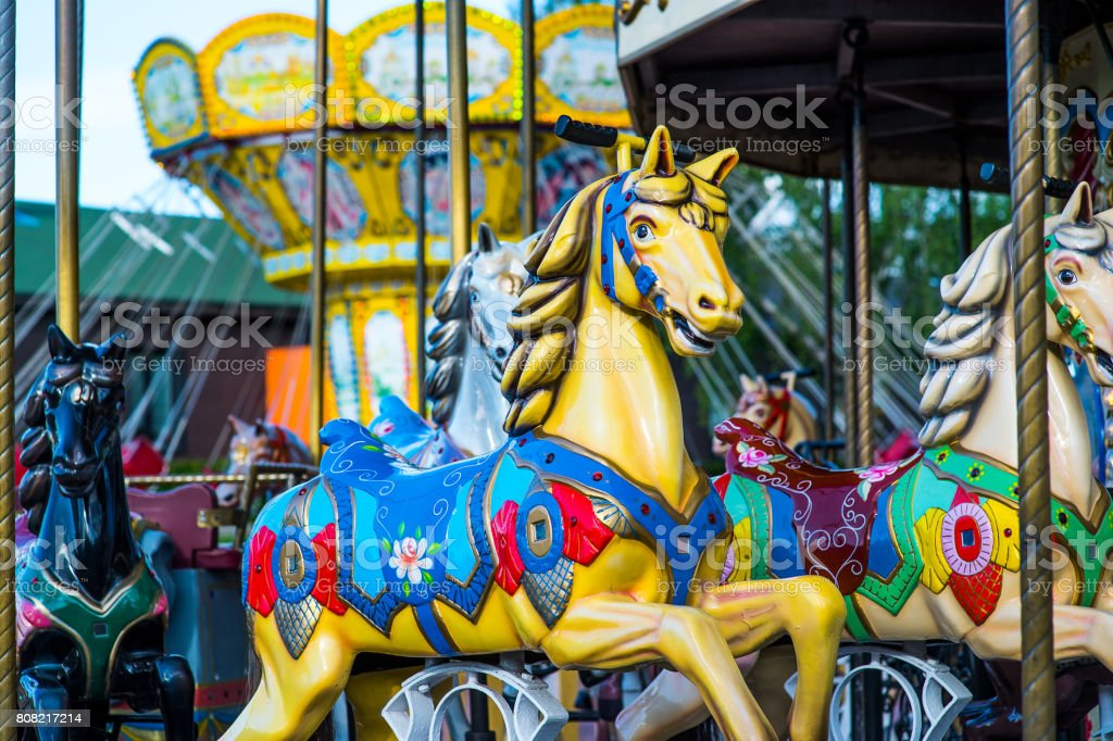 Beautiful horse Christmas carousel in a holiday park. Horses on a traditional fairground vintage carousel. Merry-go-round with horses. stock photo
