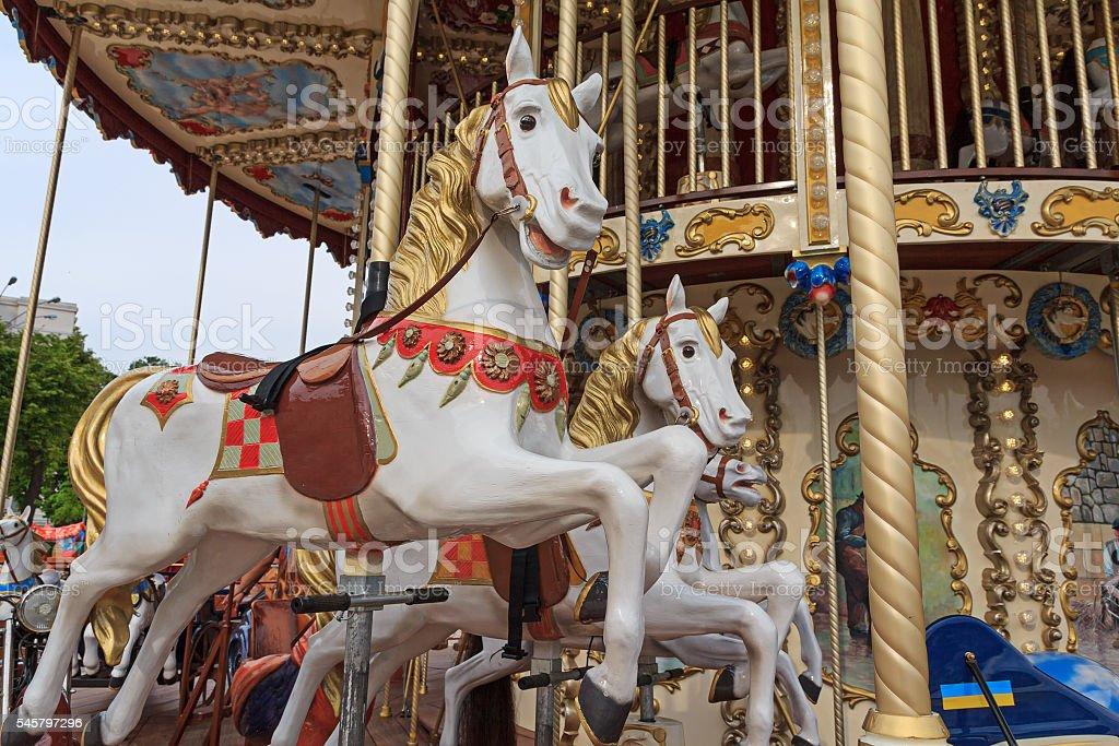 Beautiful horse on the carousel street. Carnival stock photo