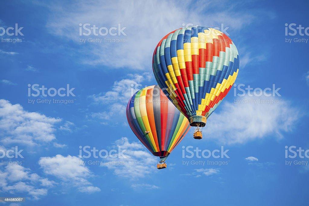 Beautiful Hot Air Balloons Against a Deep Blue Sky stock photo