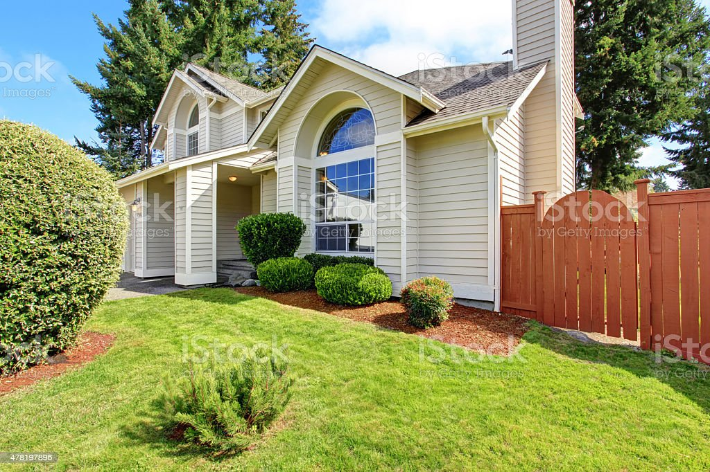 Beautiful house exterior with arch window stock photo
