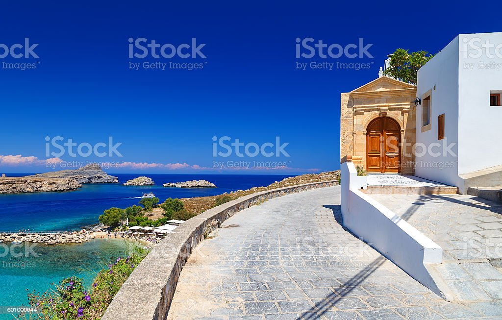 beautiful house in Lindos on background bay, yachts and ships stock photo
