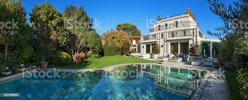 beautiful house with pool stock photo