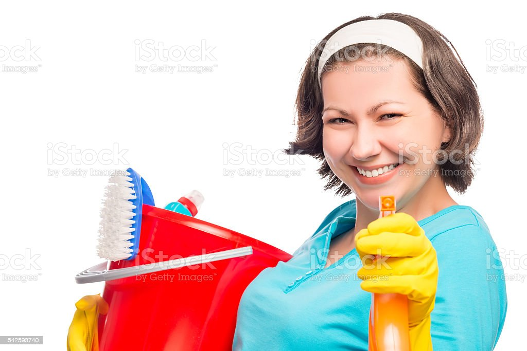 beautiful housewife smiling directs the spray into the camera stock photo