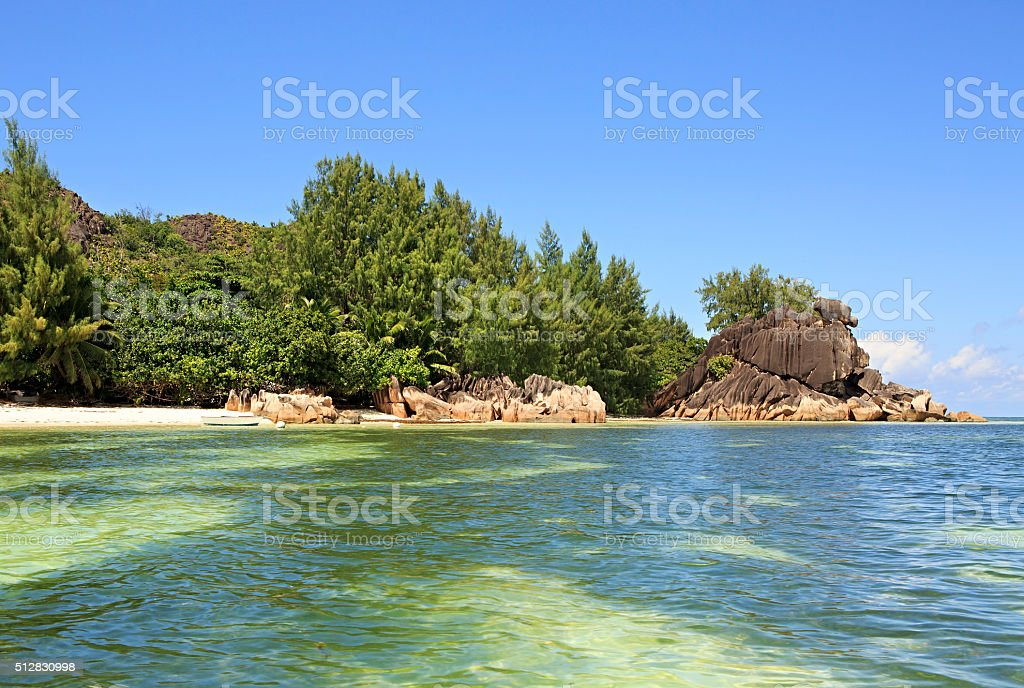 Beautiful Huge granite boulders on beach at Curieuse Island in stock photo