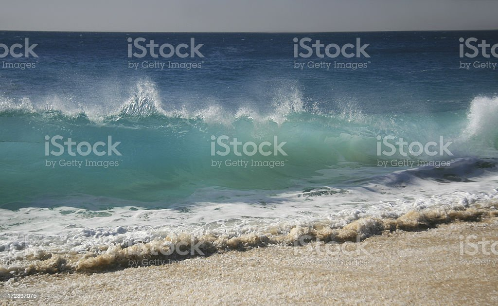 A beautiful huge wave crashing into the shore. royalty-free stock photo