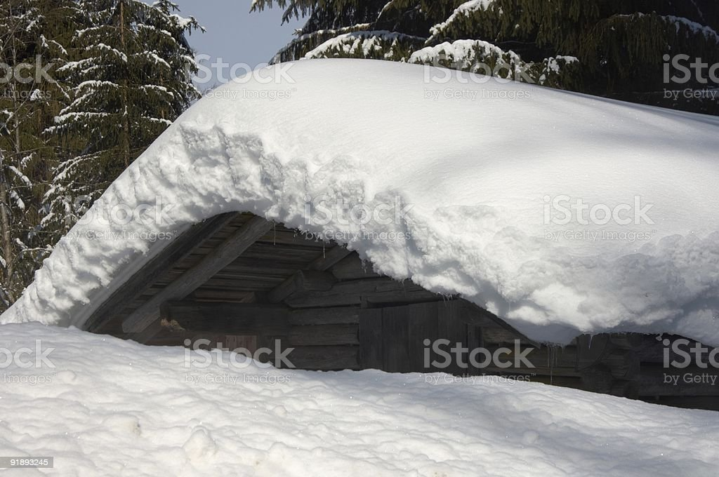 beautiful hut with much snow stock photo