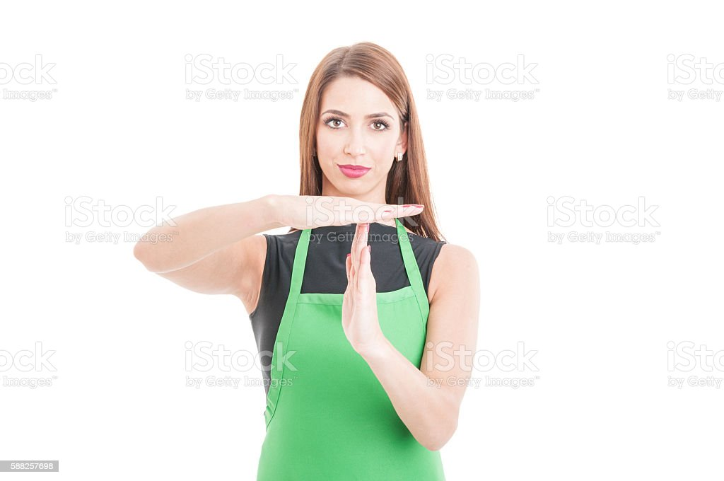 Beautiful hypermarket employee with time out gesture stock photo