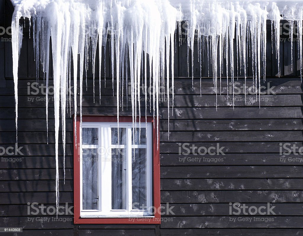 Beautiful icicles cascading from a roof and providing a view stock photo