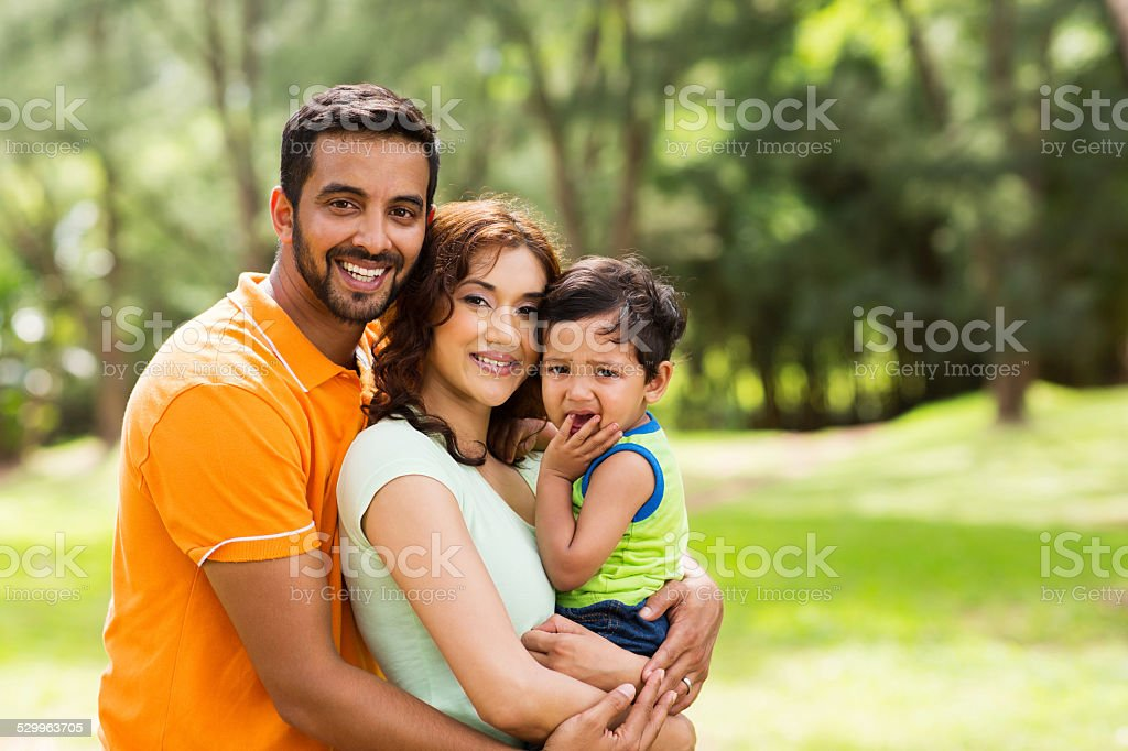 beautiful indian family outdoors stock photo