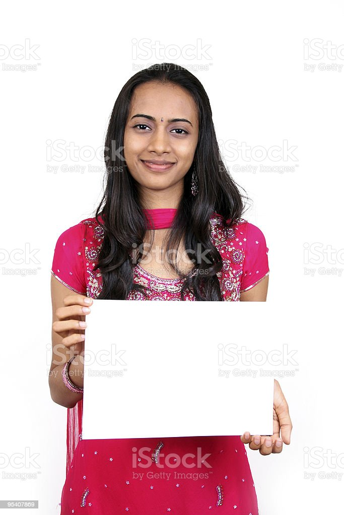 Beautiful indian girl holding a white banner. royalty-free stock photo