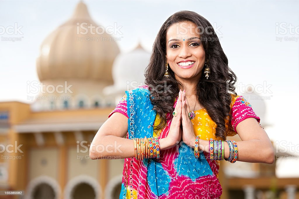 Beautiful Indian Girl Namaste stock photo