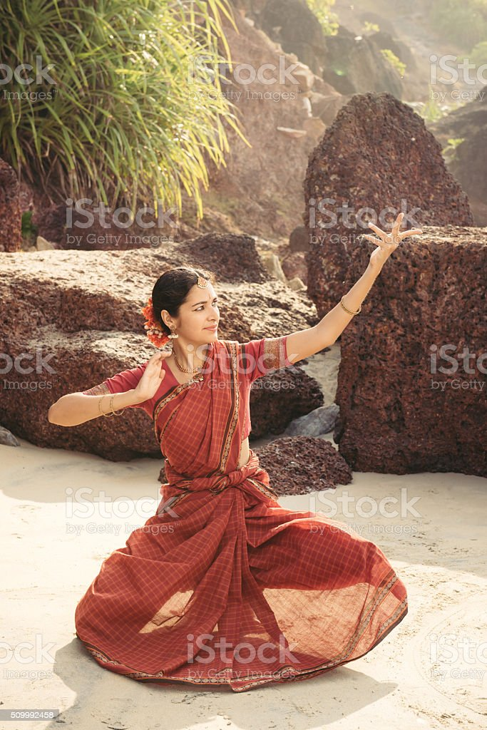 Beautiful indian woman dancer in traditional clothing stock photo