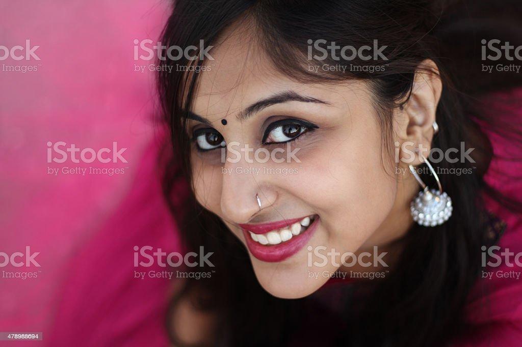 Beautiful Indian woman smiling at camera. stock photo