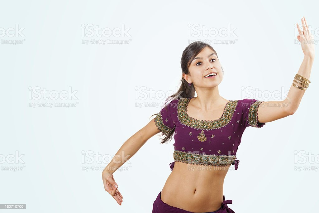 Beautiful indian young brunette woman dancing royalty-free stock photo