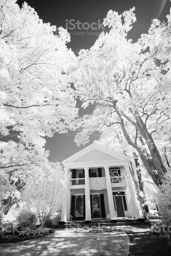 Beautiful Infrared of a Historic Colonial House with Large Trees royalty-free stock photo