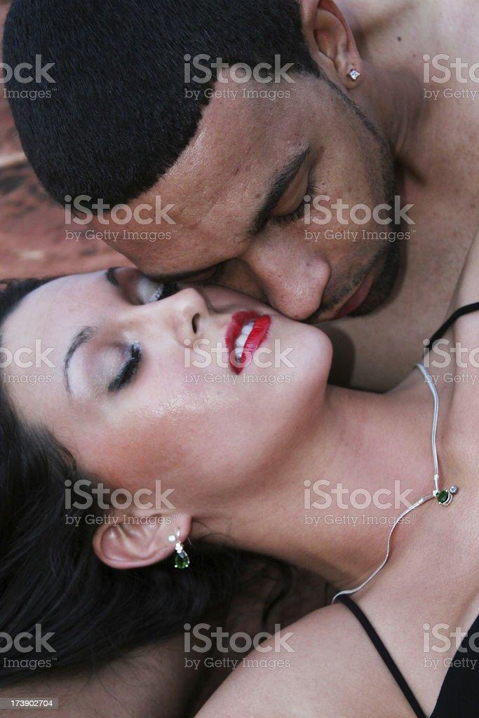 Beautiful interracial couple in romantic pose stock photo