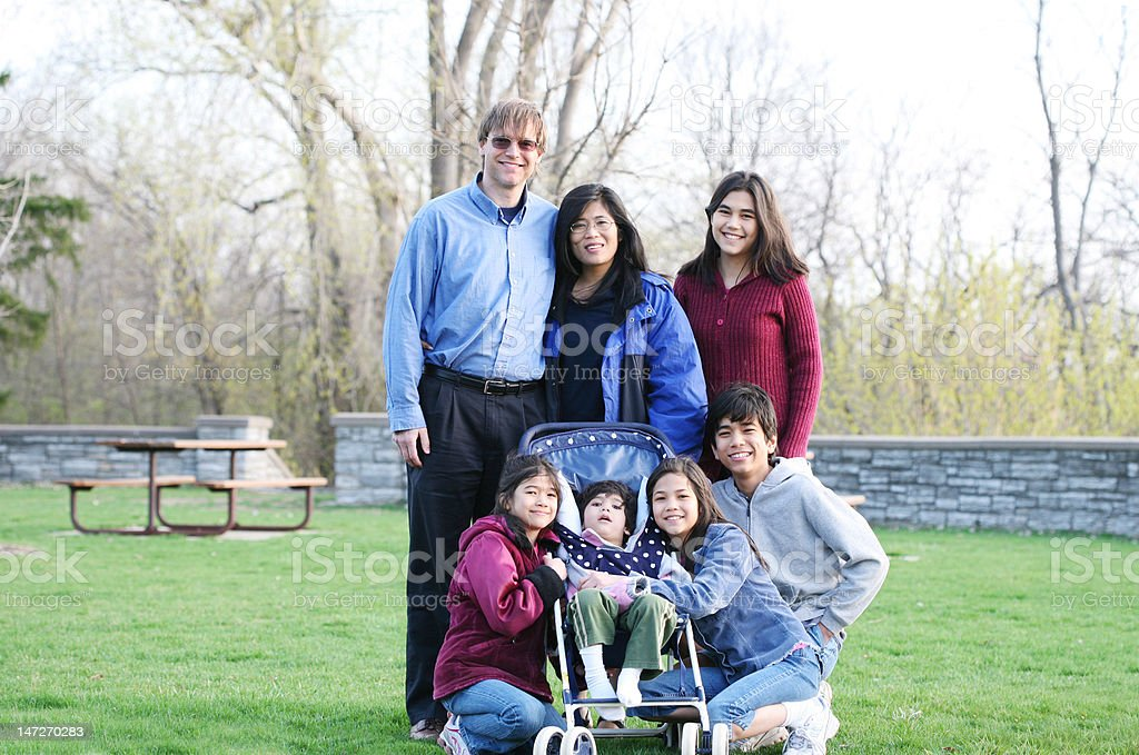 Beautiful Interracial family of seven outdoors stock photo