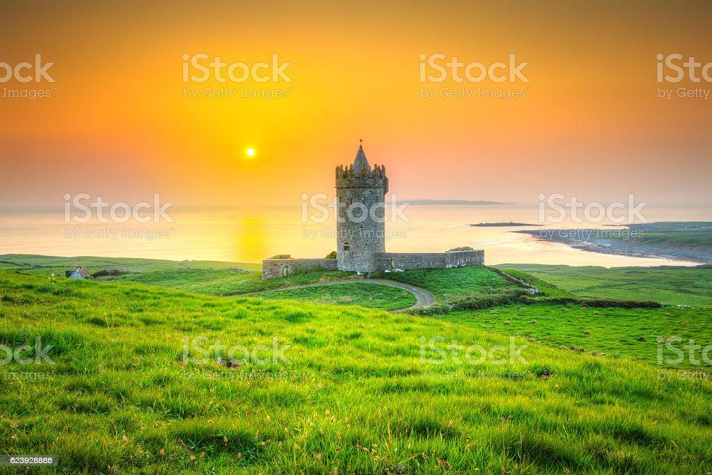 Beautiful irish castle near Atlantic ocean at sunset, Co. Clare stock photo