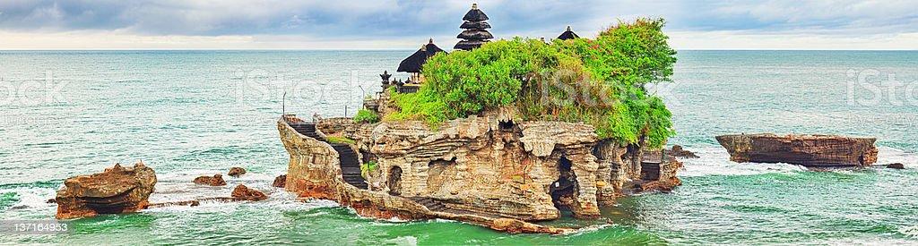 Beautiful island Tanah Lot with ocean backdrop stock photo
