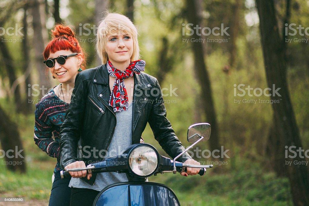 Beautiful Italian girls on motorcycle stock photo