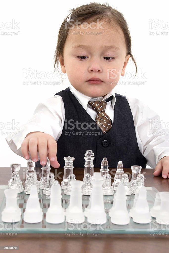 Beautiful Japanese American Girl Playing Chess royalty-free stock photo