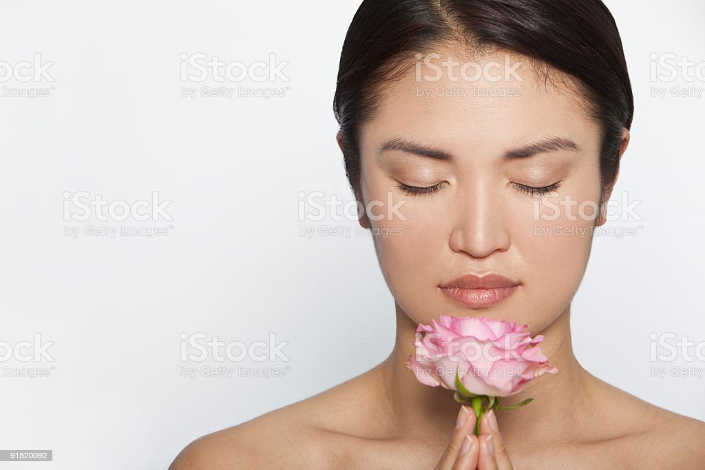 Beautiful Japanese Woman In Meditation With A Pink Rose royalty-free stock photo