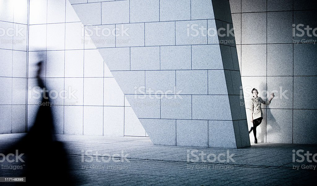 Beautiful Japanese woman in modern architectural setting stock photo