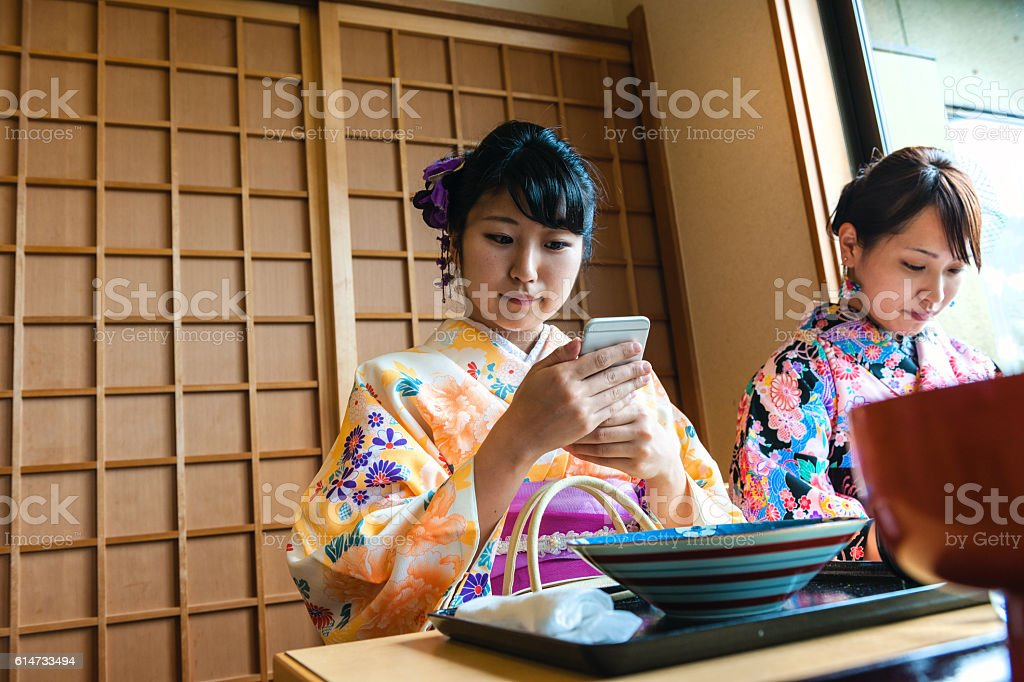 Beautiful Japanese Women in Kimono Taking Selfie, Kyoto, Japan stock photo