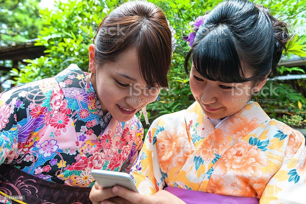 Beautiful Japanese Women in Kimono Taking Selfie, Kyoto, Japan stock photo