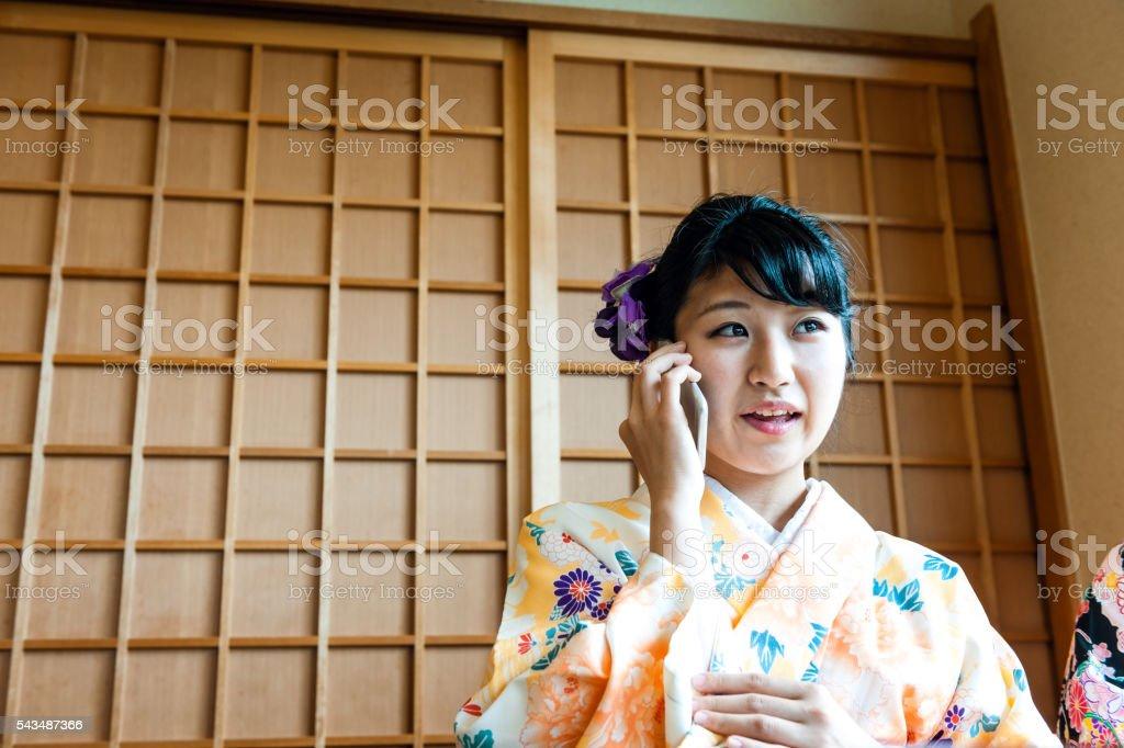 Beautiful Japanese Women in Kimono talk, talking, Kyoto, Japan stock photo