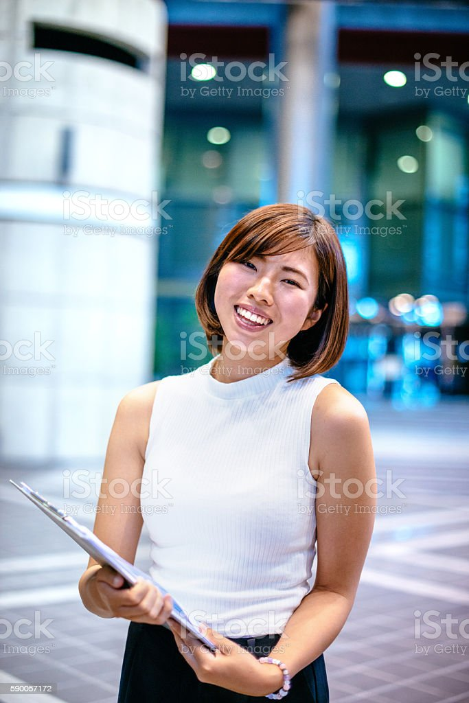 Beautiful Japanese young woman indoors stock photo