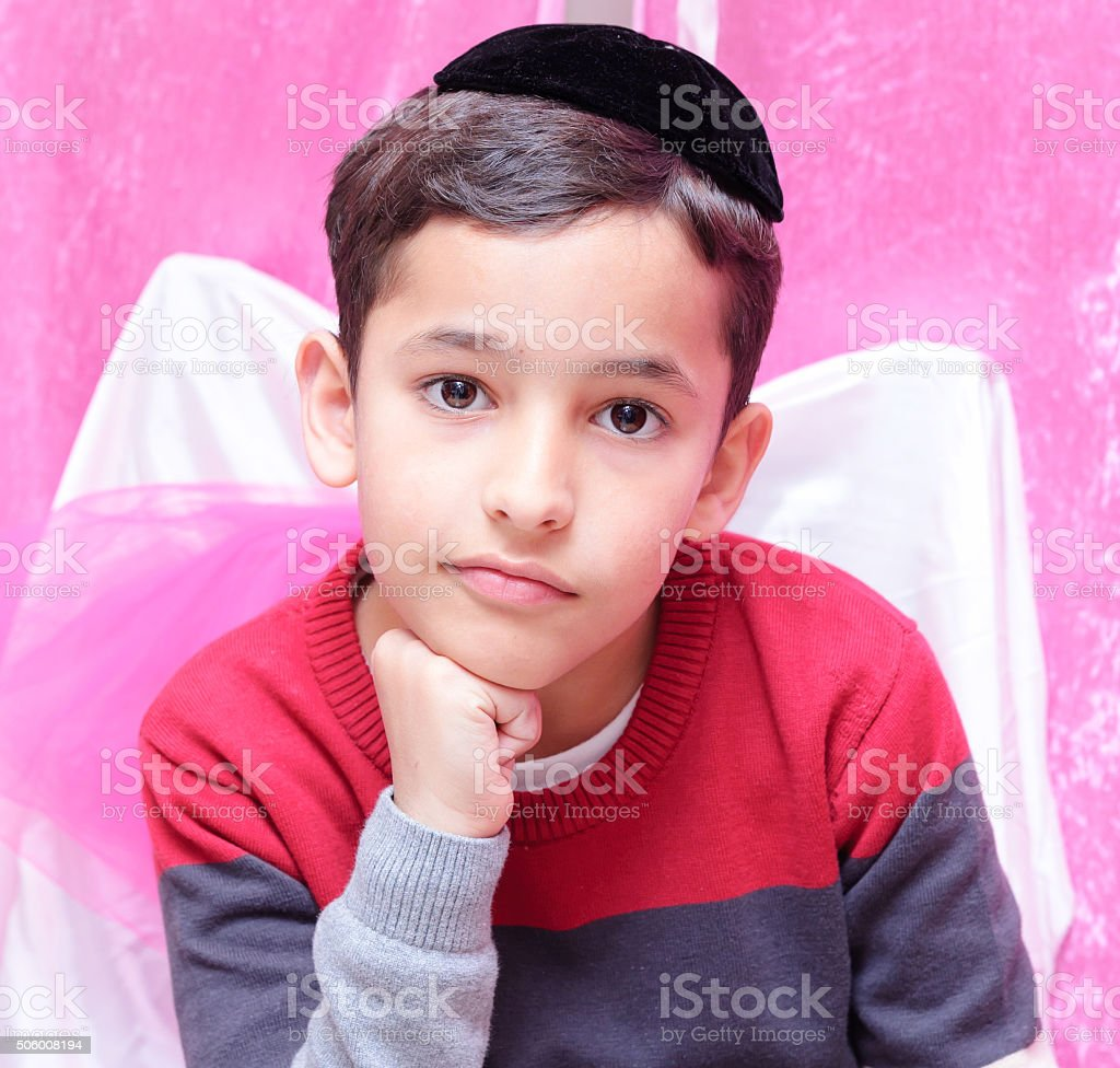 Beautiful Jewish boy with a black yarmulke, kippa in Hebrew stock photo